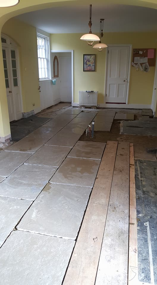 Old flooring had to be taken up for repair work to be carried out on pipes underneath, new underfloor heating was laid on insulated mats then 900x600 natural stone flag stones were laid.