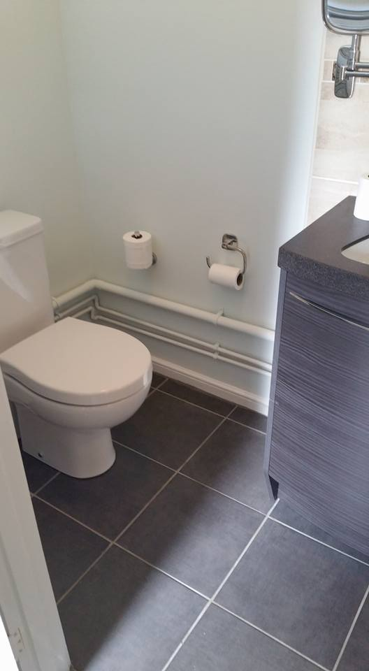 2 of 2: Downstairs toilet refurbishment: strip out, retiled floor and walls, fitted new toilet and hand basin unit, decorated.