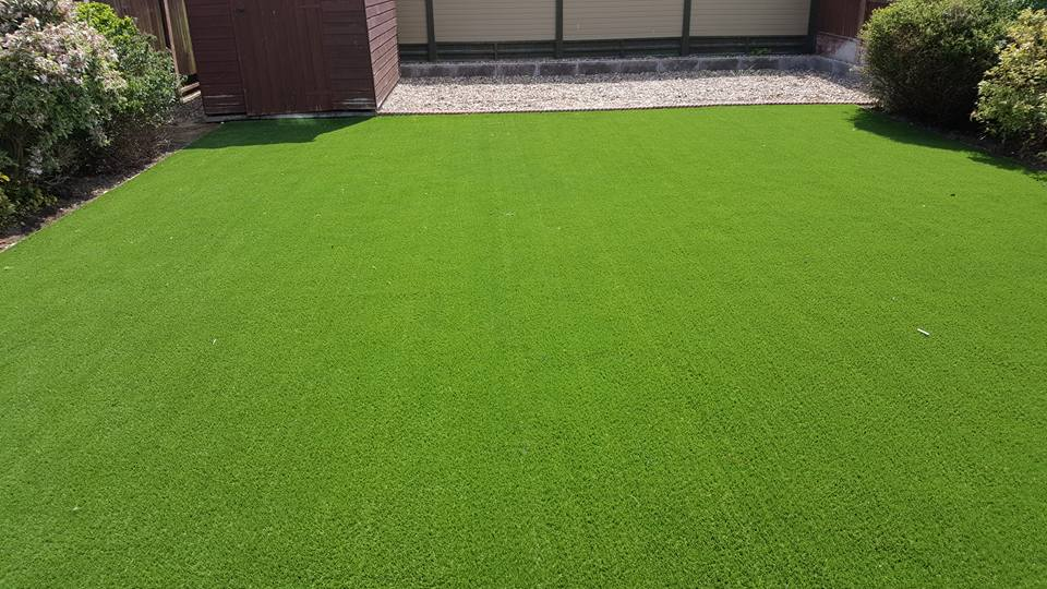 Existing lawn dug up, all necessary preparation work carried out and artificial grass laid.